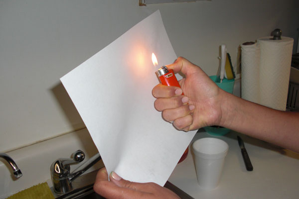 Step 4. Heat up the paper (carefully)...and watch your secret message appear!.